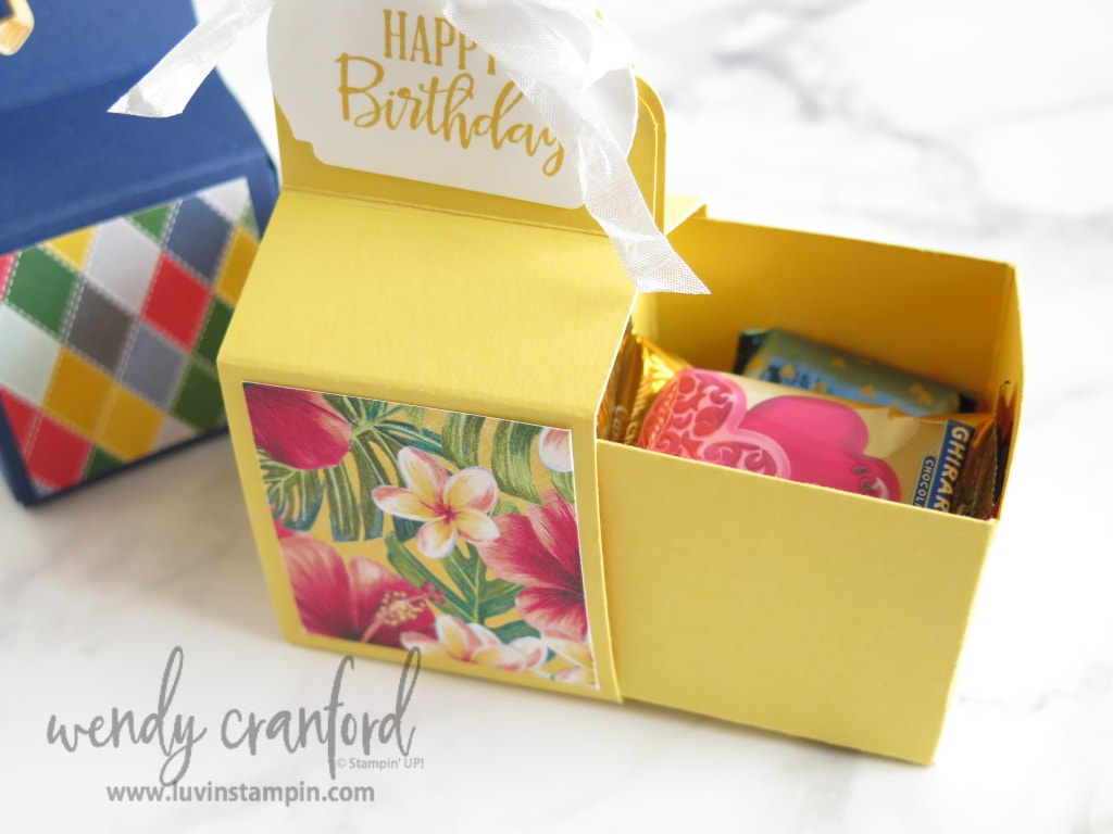 Box slides out to reveal candy and treats inside.