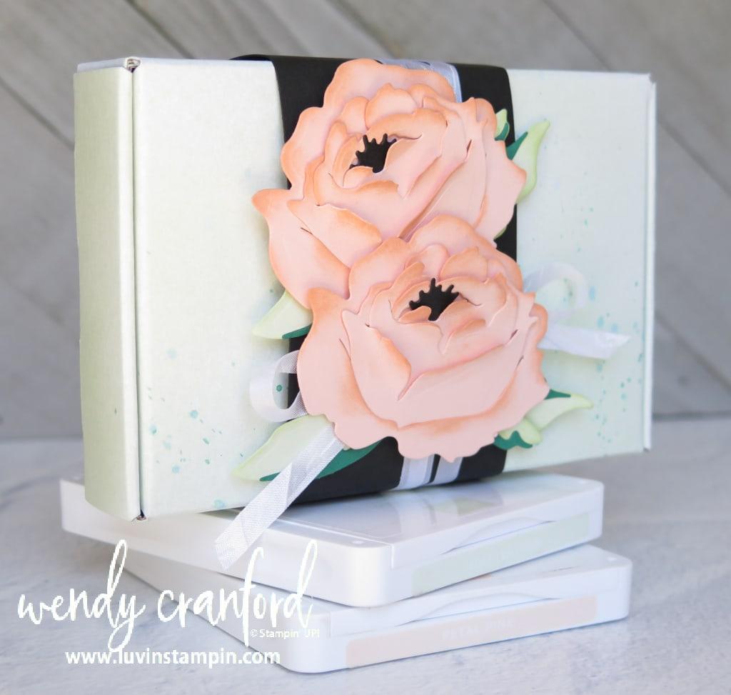 Handmade paper peony flowers on a gift box.
